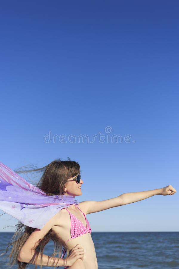 Girl on the beach enjoying a holiday at the sea. stock photo