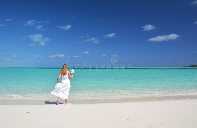 Girl on the beach of Exuma, Bahamas. Girl in the hat on the beach of Exuma, Bahamas stock image