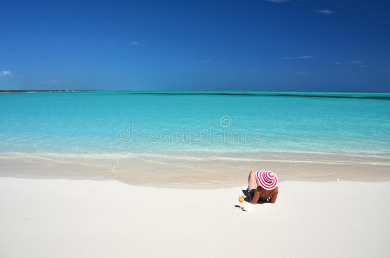 Girl on the beach of Exuma, Bahamas royalty free stock photo