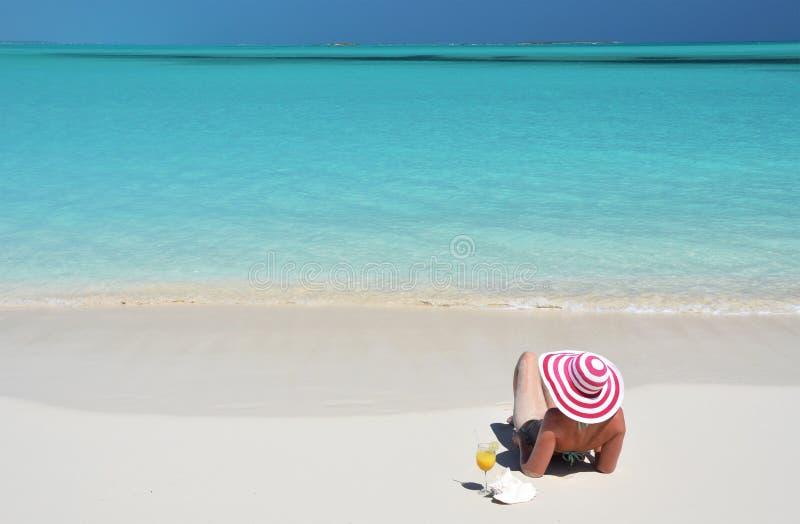 Girl on the beach of Exuma, Bahamas stock photos