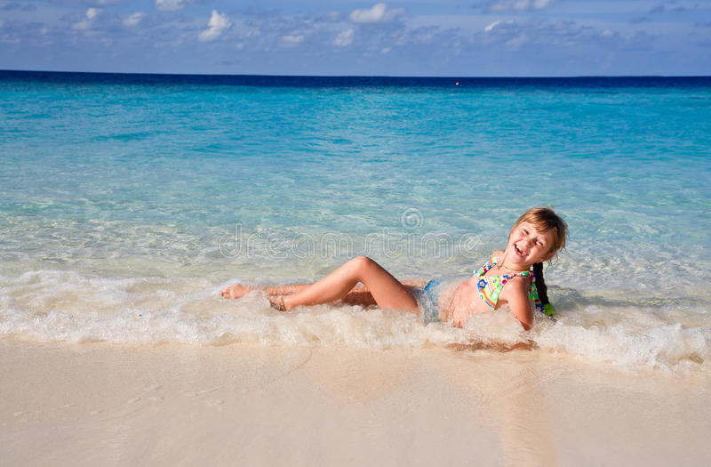 Girl on the beach having fun stock images