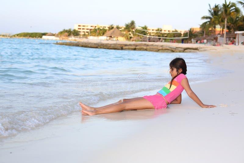 Girl by the beach. Little girl having fun on the beach royalty free stock photo