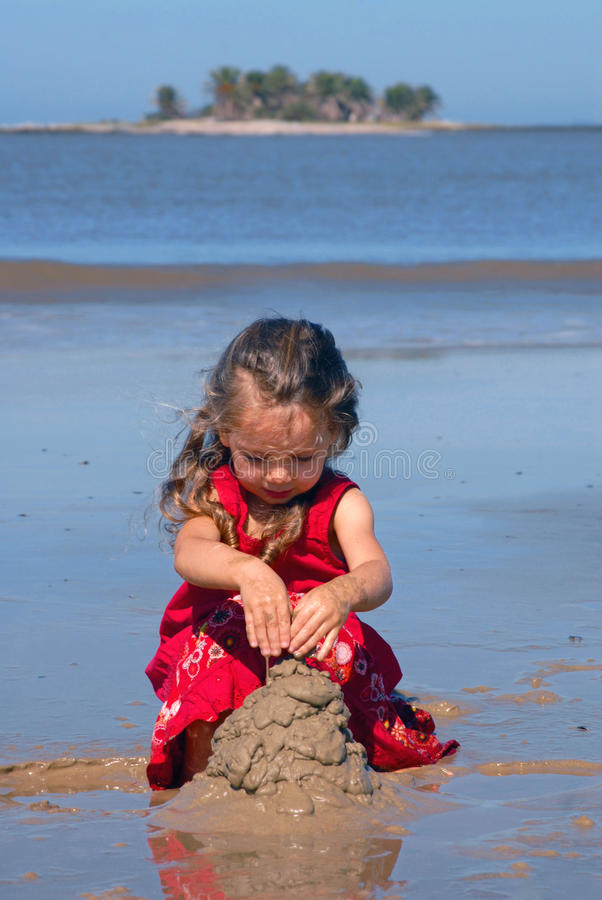 Download Girl On The Beach Playing With Sand Stock Image - Image: 11068315