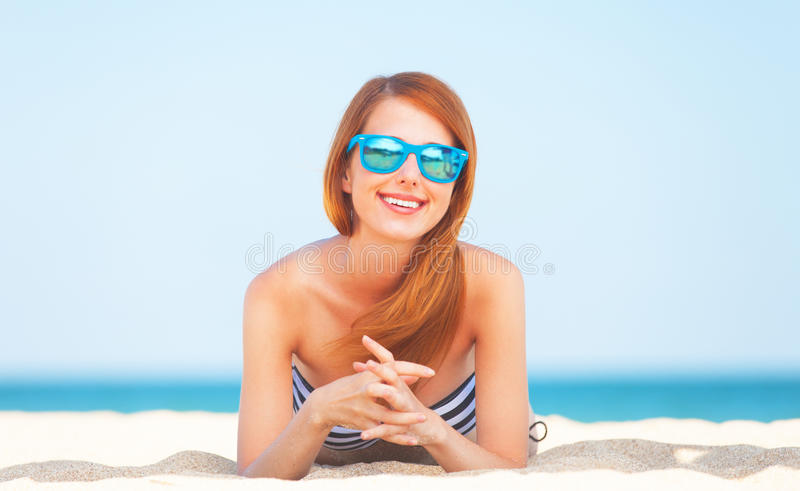 Girl on the beach. Redhead girl on the beach in spring time stock photography