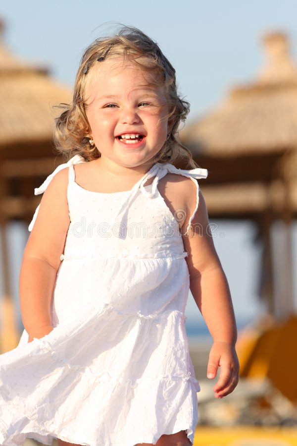 Girl at beach in the sea stock photography