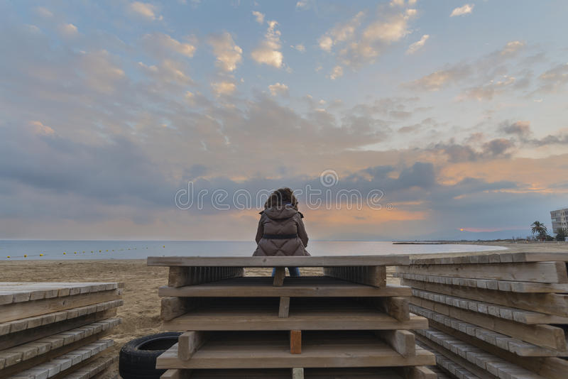 Girl on the beach. Girl sitting on the beach stock images