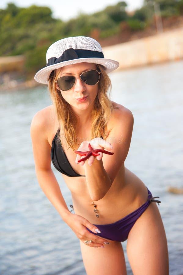 Girl At Beach With Starfish Stock Photo