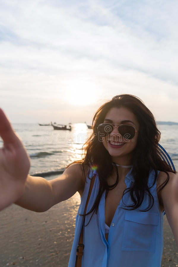 Free Girl Beach Summer Vacation, Young Woman Take Selfie Photo Sunset Stock Image - 93036541