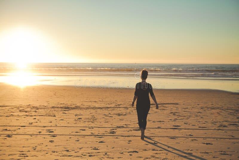 Girl on beach royalty free stock photo