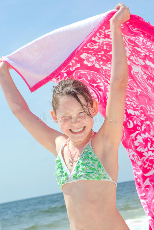 Download Girl On Beach With Towl Stock Images - Image: 13853634