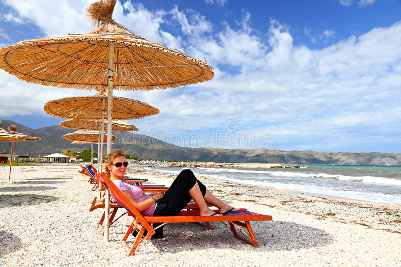 Download Girl On The Beach Under A Parasol Stock Photo - Image of lying, parasol: 17446870