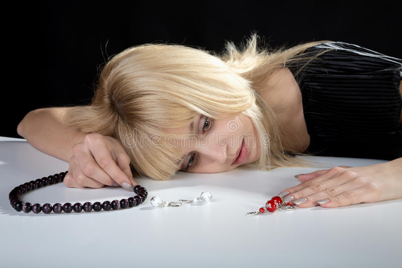 The girl with beads from pearls in a hand royalty free stock photo