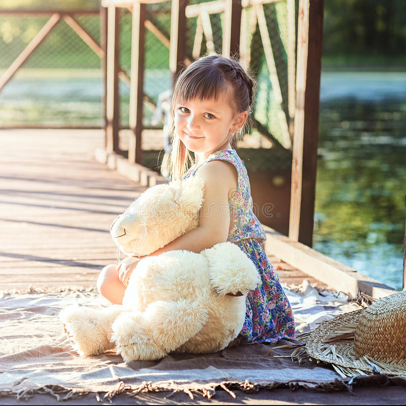Girl with a bear stock photography