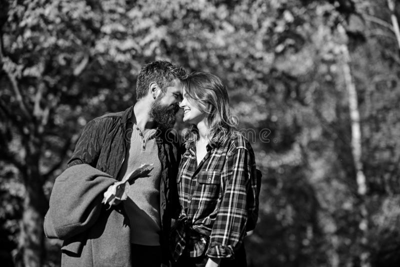 Girl and bearded guy or happy lovers on a date royalty free stock image