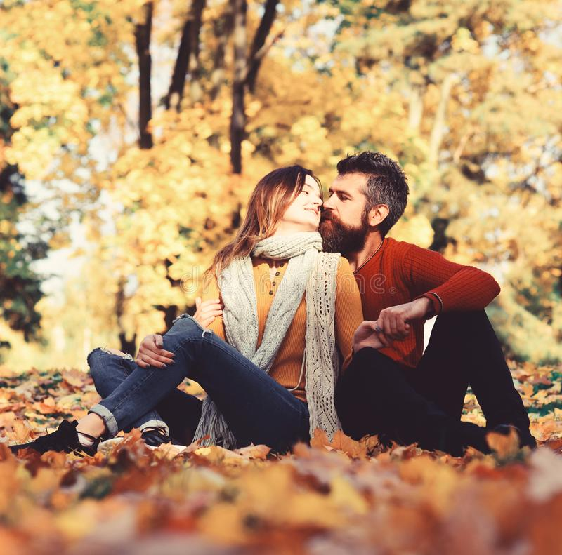 Girl and bearded guy or happy lovers on a date stock images