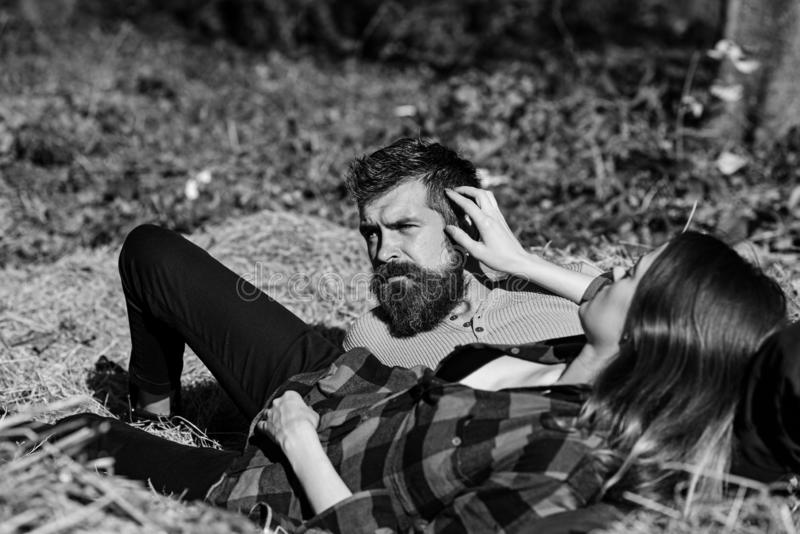 Girl and bearded guy or happy lovers on a date stock photo
