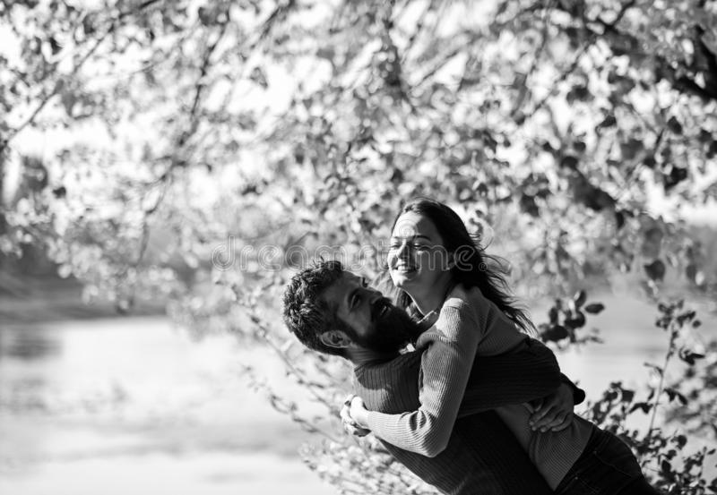 Girl and bearded guy or happy lovers on date hug royalty free stock images