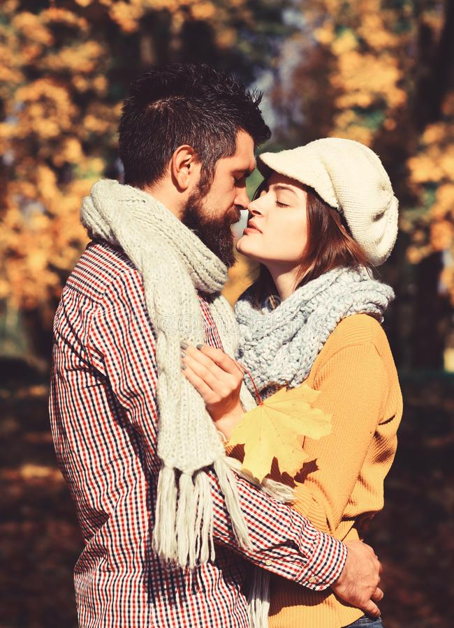 Girl and bearded guy or happy lovers on date kiss stock photos