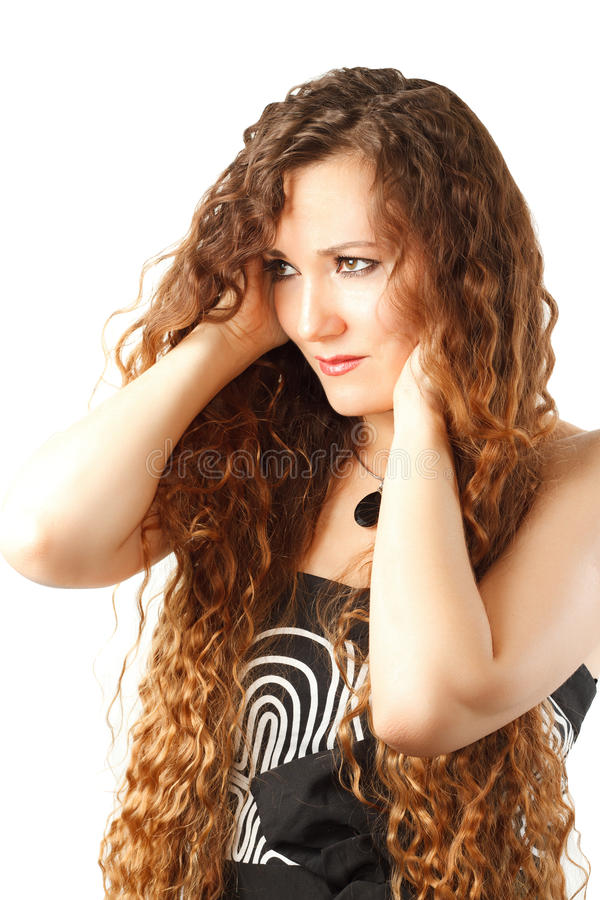 Girl with a beautiful brown curly hair stock photo