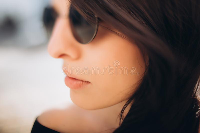 Portrait of the girl in round black glasses stock photos