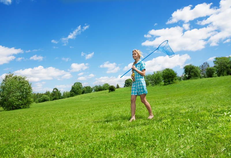 Girl and beautiful countryside landscape royalty free stock photography
