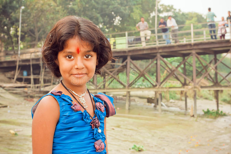Girl with beautiful eyes and tilak sign playing in indian village stock photos