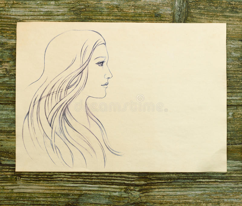 Girl beautiful hand draw sketch. Wooden background stock photos