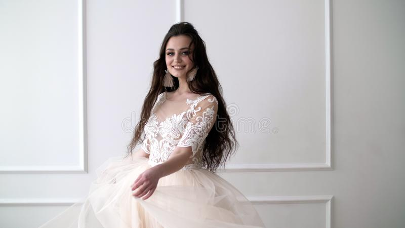 Attractive young woman in a wedding dress dancing stock photos