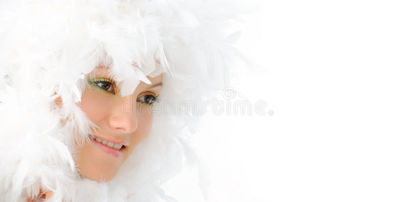 Girl with beautiful makeup and white feathers stock photo