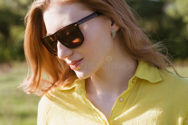 Girl, beautiful, young, blonde, big sunglasses in close-up, outdoor summer royalty free stock photos