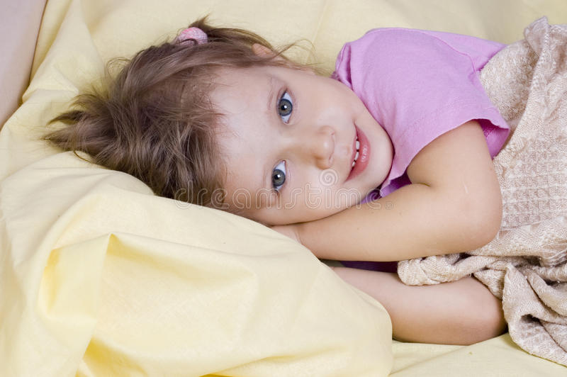 Girl bed stock photo