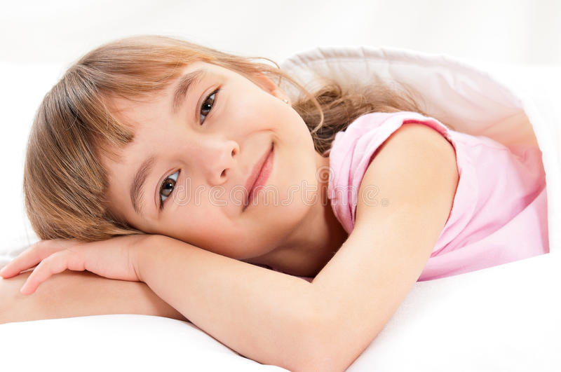 Girl on bed stock photos