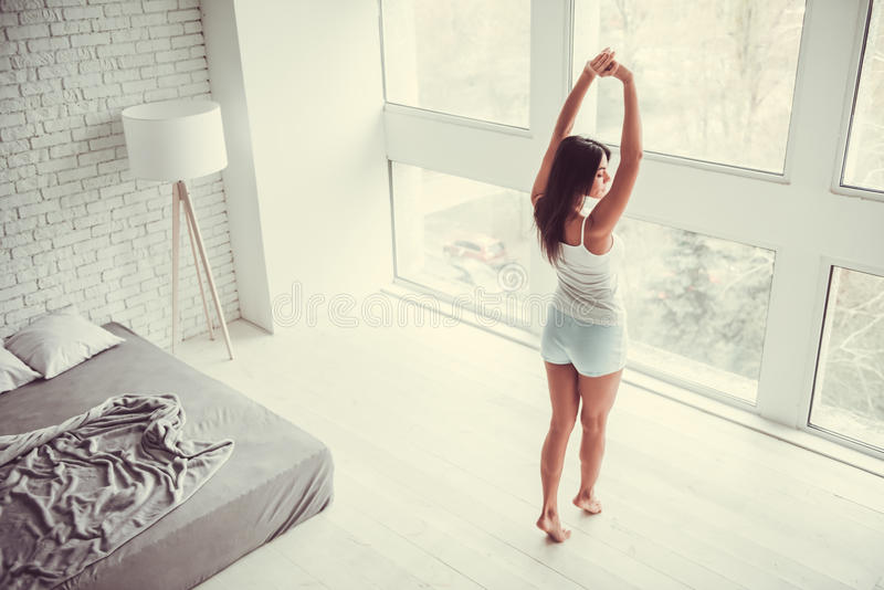 Girl in the bedroom stock photos