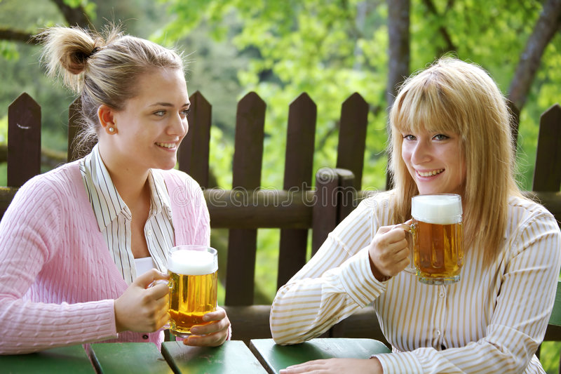 Girl with beer royalty free stock images