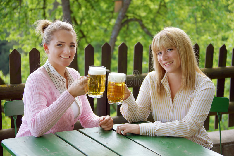 Girl with beer royalty free stock photos