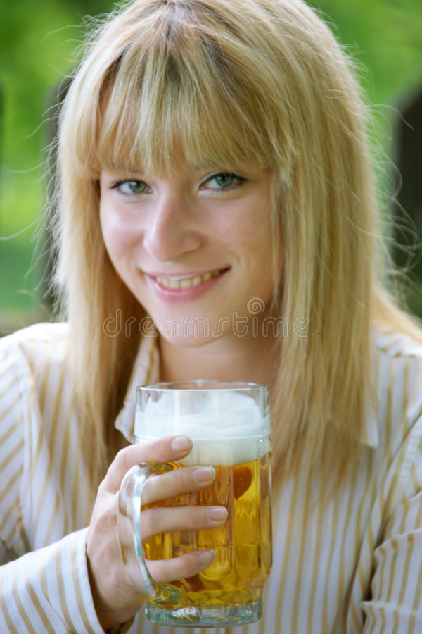 Girl with beer stock image