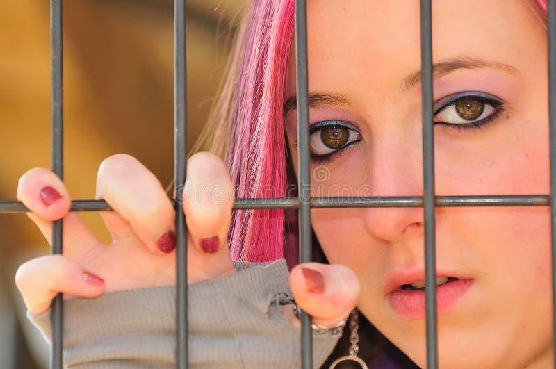 Girl behind bar royalty free stock photos