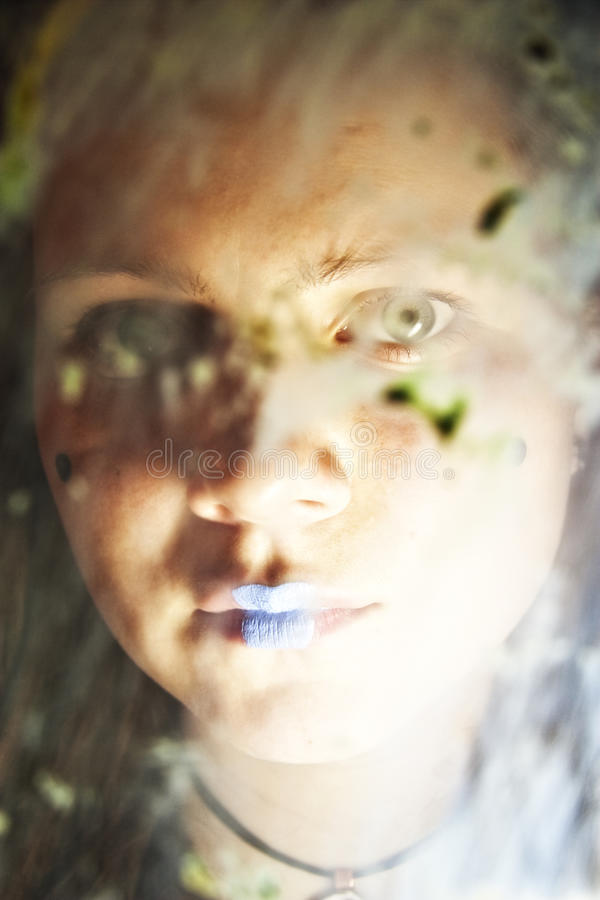 Girl Behind Dirty Glass Royalty Free Stock Images