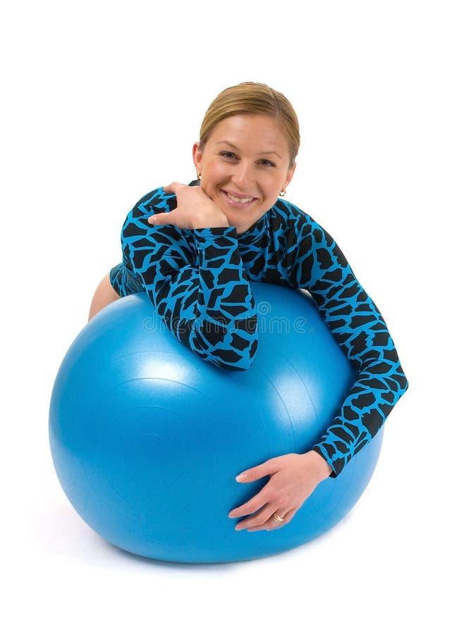 Girl behind gym ball royalty free stock photos