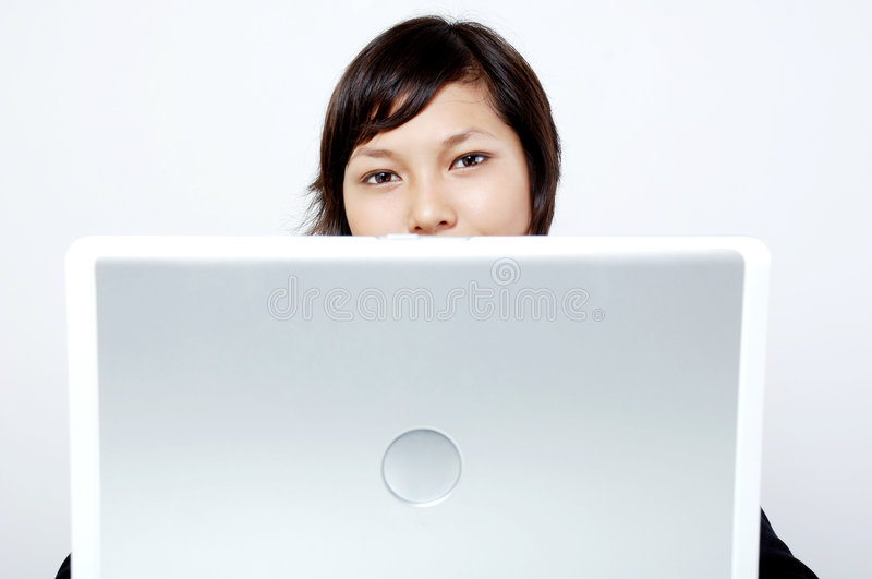 Girl behind the laptop stock photos