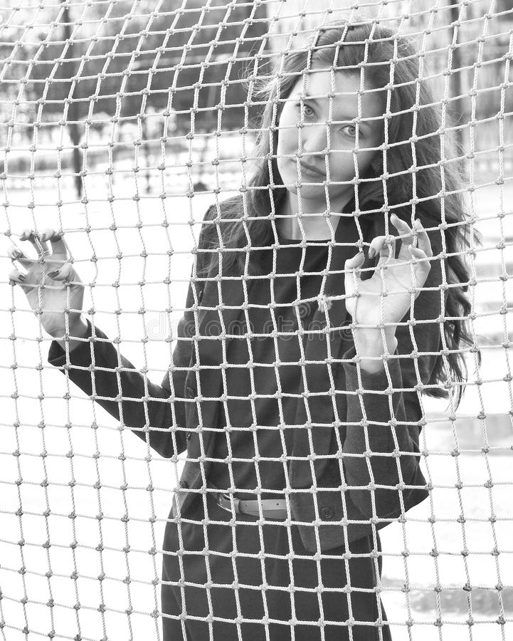 Free Girl Behind The Net Stock Images - 21353974