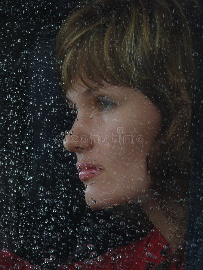 Free Girl Behind Waterdropped Glass Stock Images - 2659034