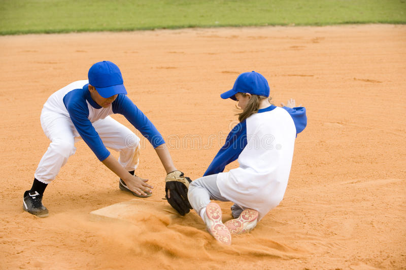 girl being run out in baseball stock photo