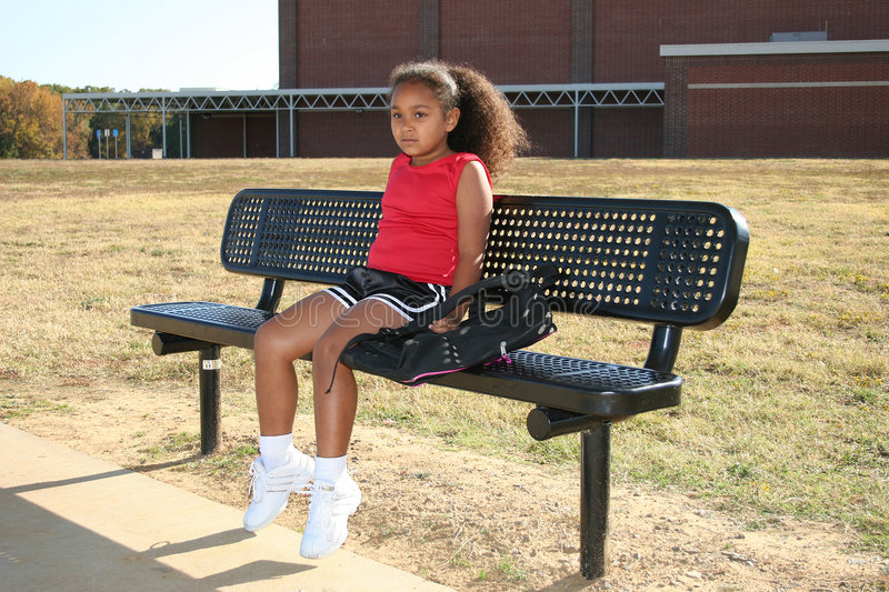 Girl on bench. Girl wearing summery clothes sat on bench stock photos