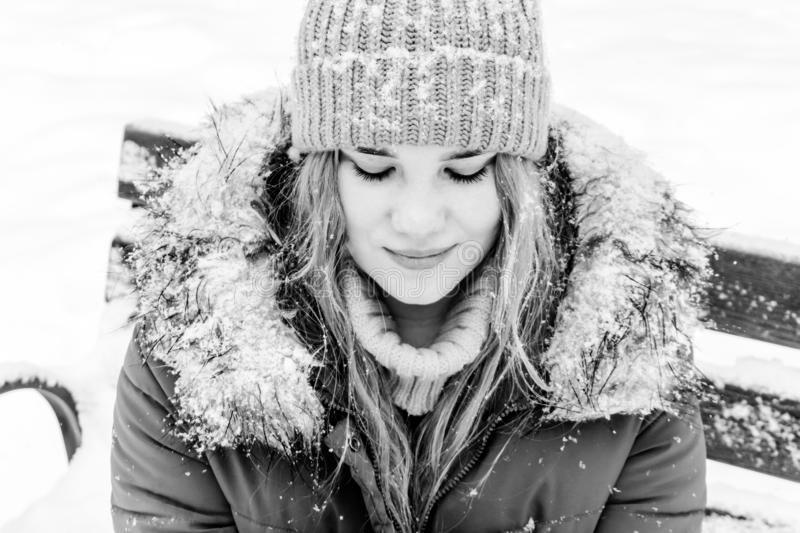 Girl on a bench in winter park stock images