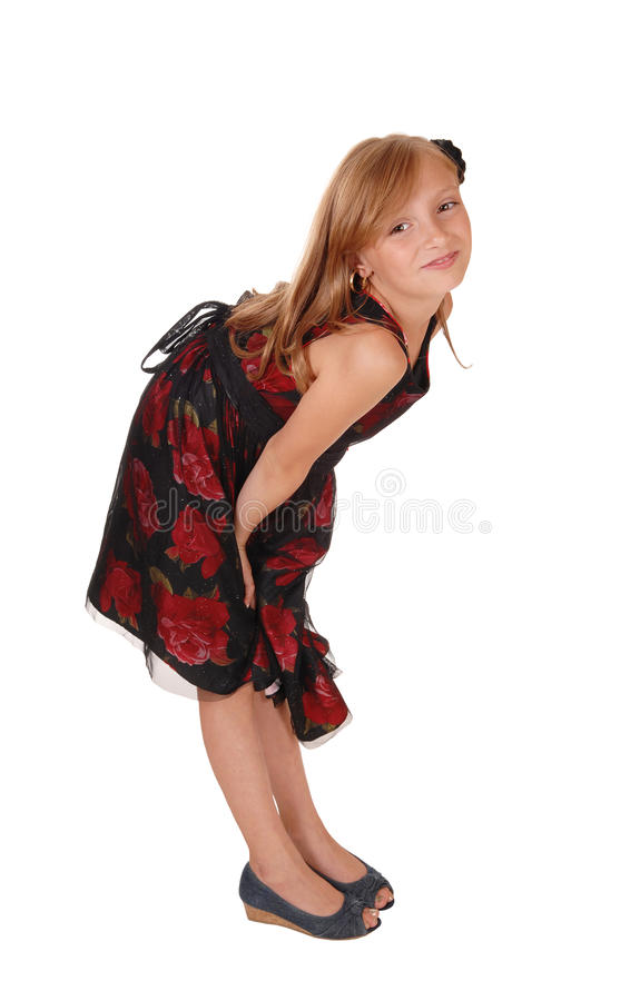 Girl bending down. stock image