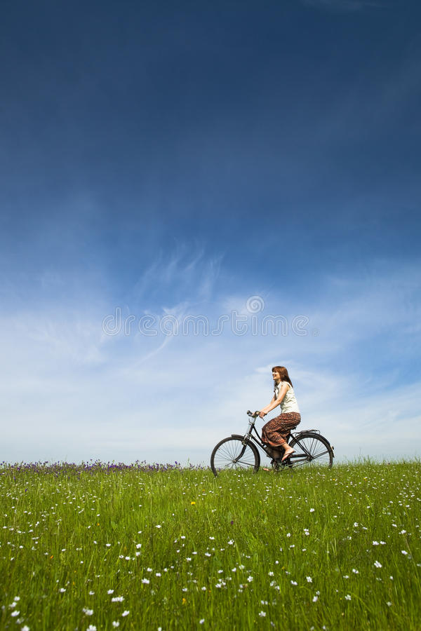 Girl with a bicycle royalty free stock image