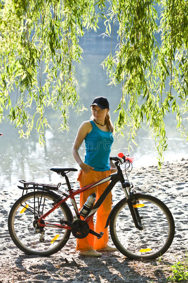 Girl with bicycle. royalty free stock image