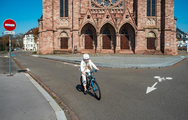 Girl on a bicycle in the empty city of Strasbourg stock image