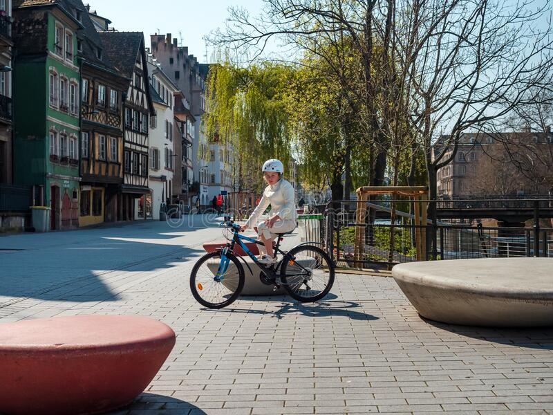 Girl on a bicycle in the empty city of Strasbourg royalty free stock images